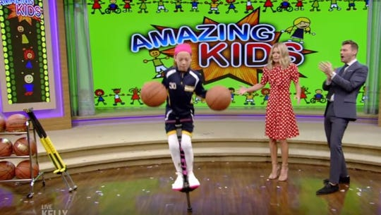 """Karolina Ramirez, 10, bounces on a Pogo stick while dribbling two basketballs during the """"Amazing Kids"""" Week on """"Live with Kelly and Ryan."""""""
