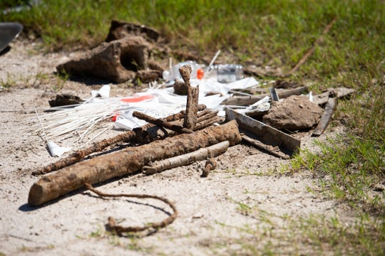 Debris turned up during a search for World War II-era munitions by Army Corps of Engineers contractors, Arcadis, is seen Thursday, Sept. 27, 2018, in a lot on the 1200 block of Little Harbour Lane in Indian River County.