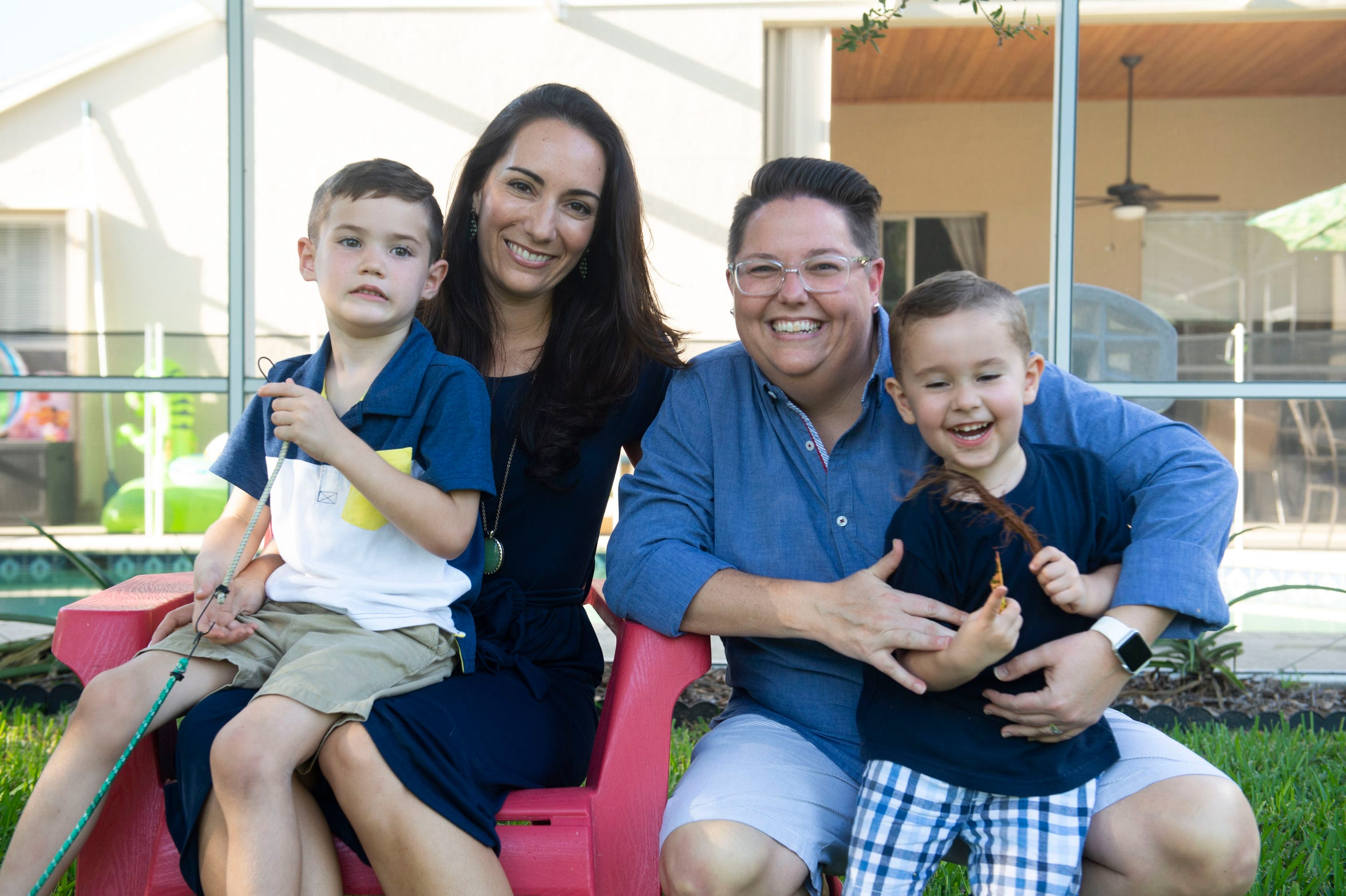 """For Lisa Davis (second from left) and her wife, Corinne Davis, the birth of their children Beckett (left), 5, and Thatcher, 3, have changed their focus on political issues. """"If you ask me what my priority is this election, it's my kids. It's education. It's school, school, school,"""" Corinne said. """"We moved up to Martin County for the great schools and are so happy with the staff where our son is,"""" Lisa said. """"But the building has been deemed functionally obsolete. It's a 60-year-old building and the funding just isn't there to replace it. Hopefully voters understand that the schools are a representation of the whole community."""""""