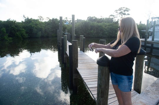 "Central Marine owner Mary Radabaugh documents water overtaken with blue-green algae Thursday, Sept. 27, 2018 in Stuart. ""The smell is just gross,"" Radabaugh said. ""This is as bad as it was in 2016, the smell. It's really that bad."""