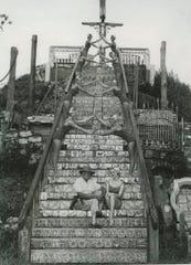 Waldo Sexton poses on his mountain with the Vero Beach Dolphinettes.