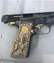 """El Cuate"" is written on a gun seized during the arrest of reputed Sinaloa drug cartel leader Leonel ""El Cuate"" Salgueiro"