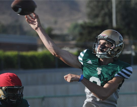 Quarterback Gavin Beerup lets a pass fly during St. Bonaventure's practice Wednesday. Beerup and the 5-1 Seraphs open Marmonte League play Friday night at Newbury Park.