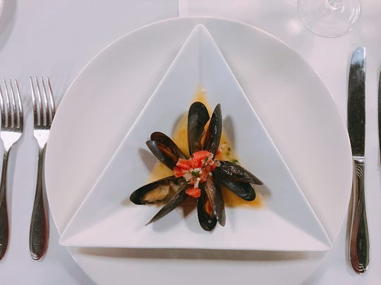 An appetizer of saffron-infused mussels is seen at The Bistro, the on-campus restaurant operated by students at the culinary arts and restaurant management program at Oxnard College. After many years of dinner service, The Bistro is now offering lunch.