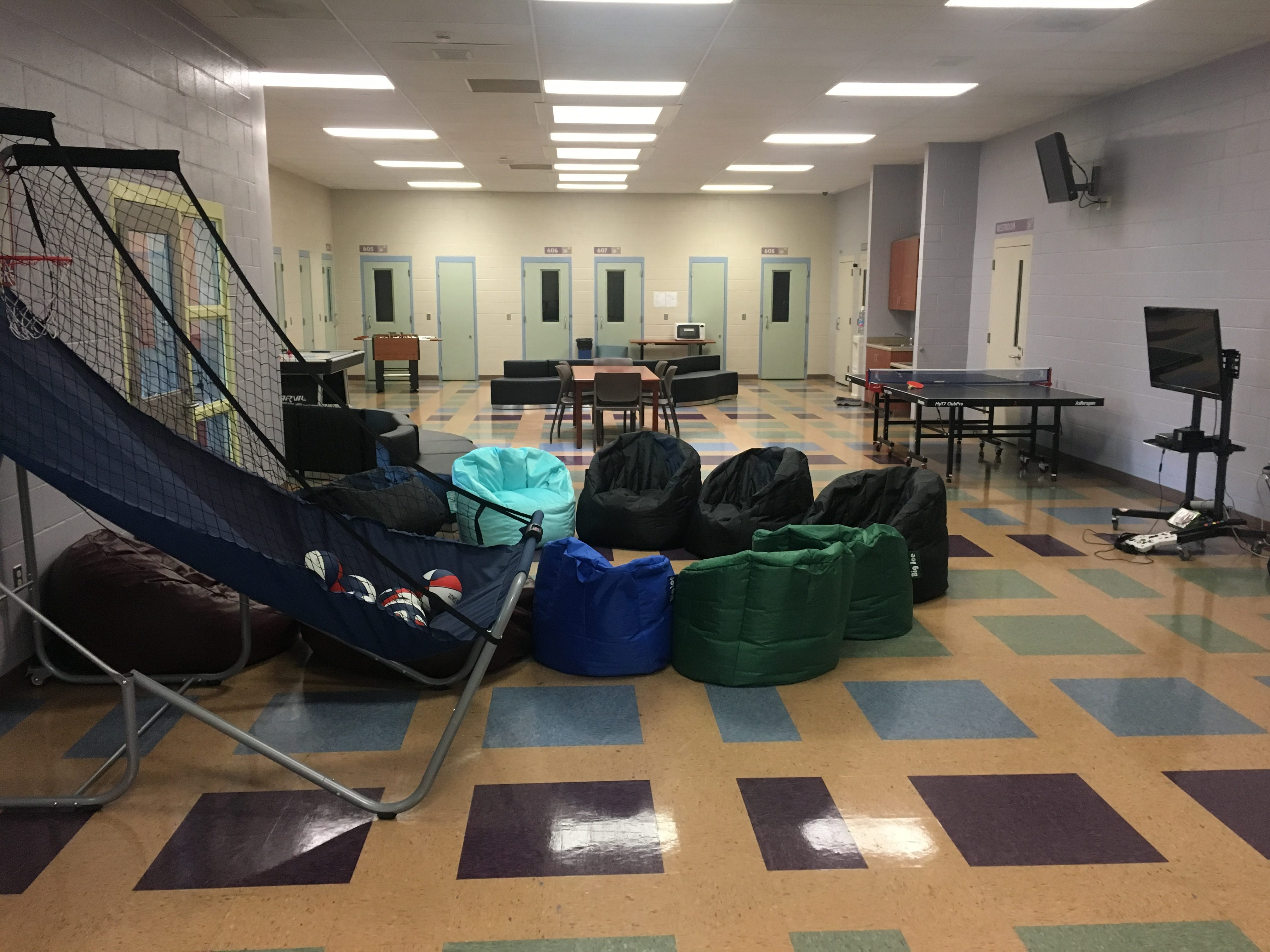 A common area at Ventura County Juvenile Hall in El Rio includes bean bag chairs and games. Youths can earn rewards such as movies and games through good behavior.