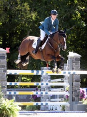Peter Lutz and his horse Excellent compete in the $2,500 Staller 1.35m Jumper during the American Gold Cup at Old Salem Farm in North Salem Sept. 27, 2018. The world-class international show jumping competition will continue though Sunday, Sept. 30, 2018.