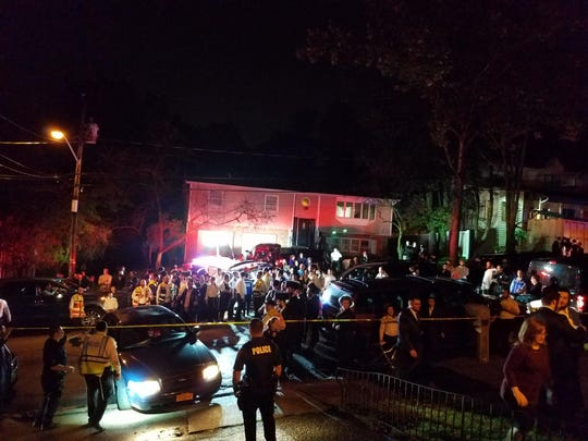 Spring Valley police help control the crowd outside 18 Sam Law Drive, where a deck collapsed at a home on Sept. 26, 2018.