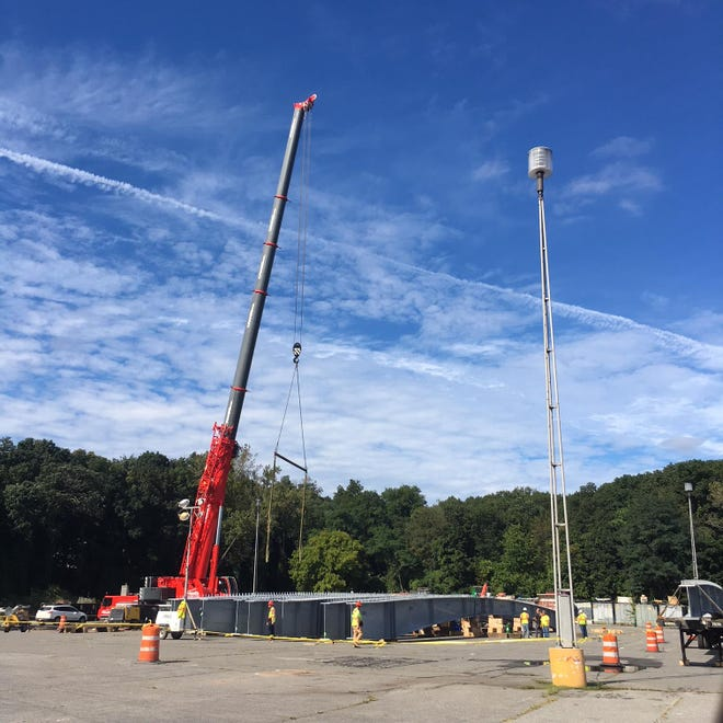 Structural steel for this weekend's bridge replacement project over the Hutchinson River Parkway is being assembled in Playland parking lot.