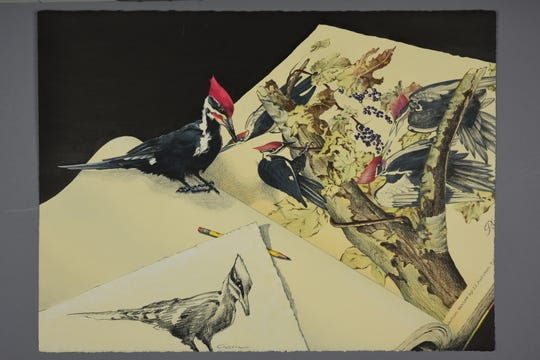 """Charles Guerin, executive director of The Biggs Museum of American Art, will be the featured artist at the state's gallery in the Carvel State Office Building. This is his """"Still Life with Pileated Woodpecker and Yellow Pencil."""""""