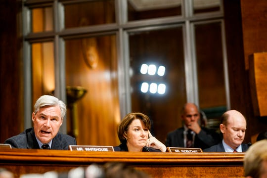 Left to right, Sen. Sheldon Whitehouse (D-R.I.), Sen. Amy Klobuchar (D-Minn.) and Sen. Christopher A. Coons (D-Del.) at a Senate Judiciary Committee hearing on Thursday, September 27, 2018 on Capitol Hill. (Melina Mara/Pool Photo via AP)