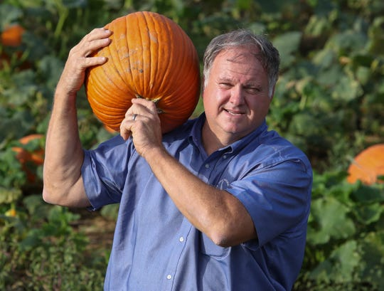 """Stewart Ramsey says this season's weather has been """"exhausting."""" Heat and heavy rains are proving to be a challenge for farmers in the area, and Ramsey is hoping for good weather on weekends, especially, to support sales of his pumpkins and fall entertainment at Ramsey's Farm."""