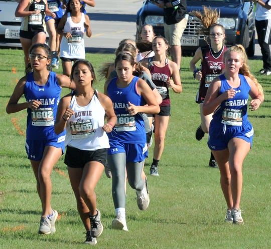 Bowie Junior Varsity student Sierra Skinner leads a small group of girls during a cross country meet held at Garnett Field Thursday morning.