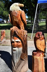This bald eagle and tree spirit sculpture was created by chainsaw carver Jimmy Hobbs of Mineola using the trunk of a Sycamore tree.