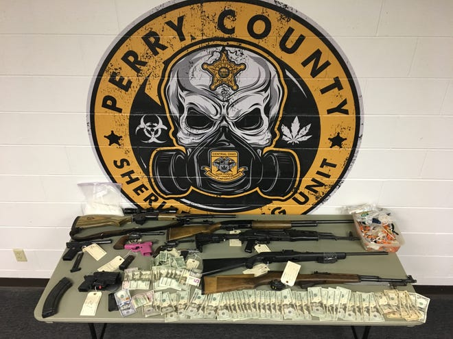 The Perry County Sheriff's Office displays items collected during one of two drug busts in New Straitsville last week.