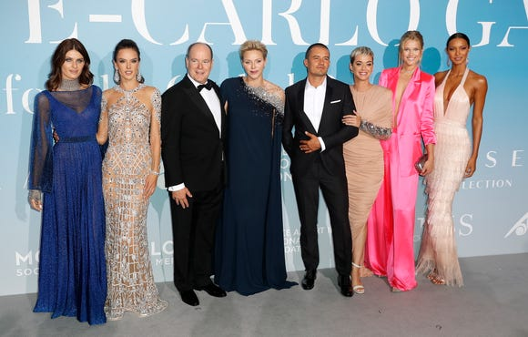 There's a little affection. Perry and Bloom pose with models and royalty: Prince Albert II of Monaco and his wife, Princess Charlene, fourth from left.