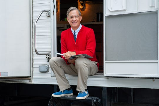 Tom Hanks, shown here on the set of his upcoming film, is officially in Mister Rogers' red cardigan.