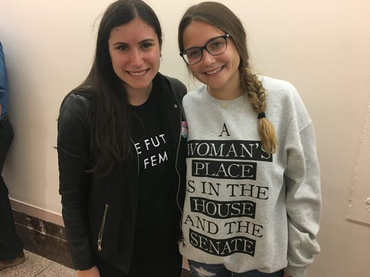 University of Maryland students Bailey Dinman, left, and Michelle Garda wait outside an overflow room to watch the Senate Judiciary Committee hearing on allegations of sexual assault on Sept. 27, 2018.