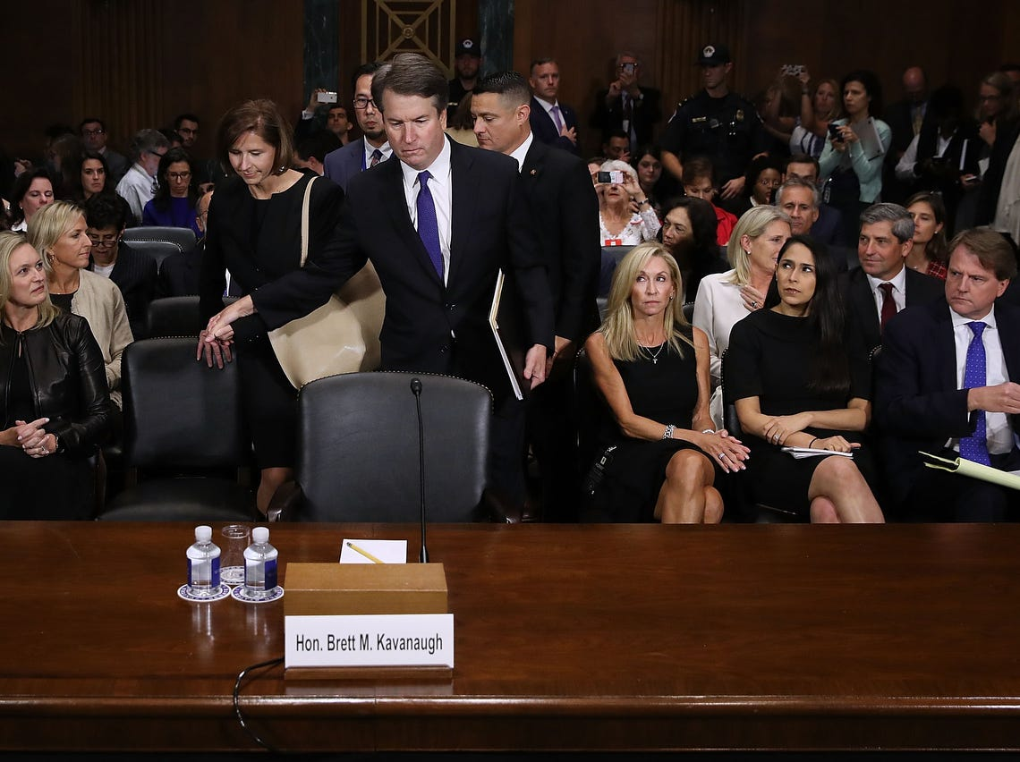 WASHINGTON, DC - SEPTEMBER 27:  Judge Brett Kavanaugh (C) holds hands with his wife Ashley Kavanaugh as he arrives to testify to the Senate Judiciary Committee during his Supreme Court confirmation hearing in the Dirksen Senate Office Building on Capitol Hill September 27, 2018 in Washington, DC. Kavanaugh was called back to testify about claims by Christine Blasey Ford, who has accused him of sexually assaulting her during a party in 1982 when they were high school students in suburban Maryland.  (Photo by Win McNamee/Getty Images) ORG XMIT: 775234142 ORIG FILE ID: 1041965792