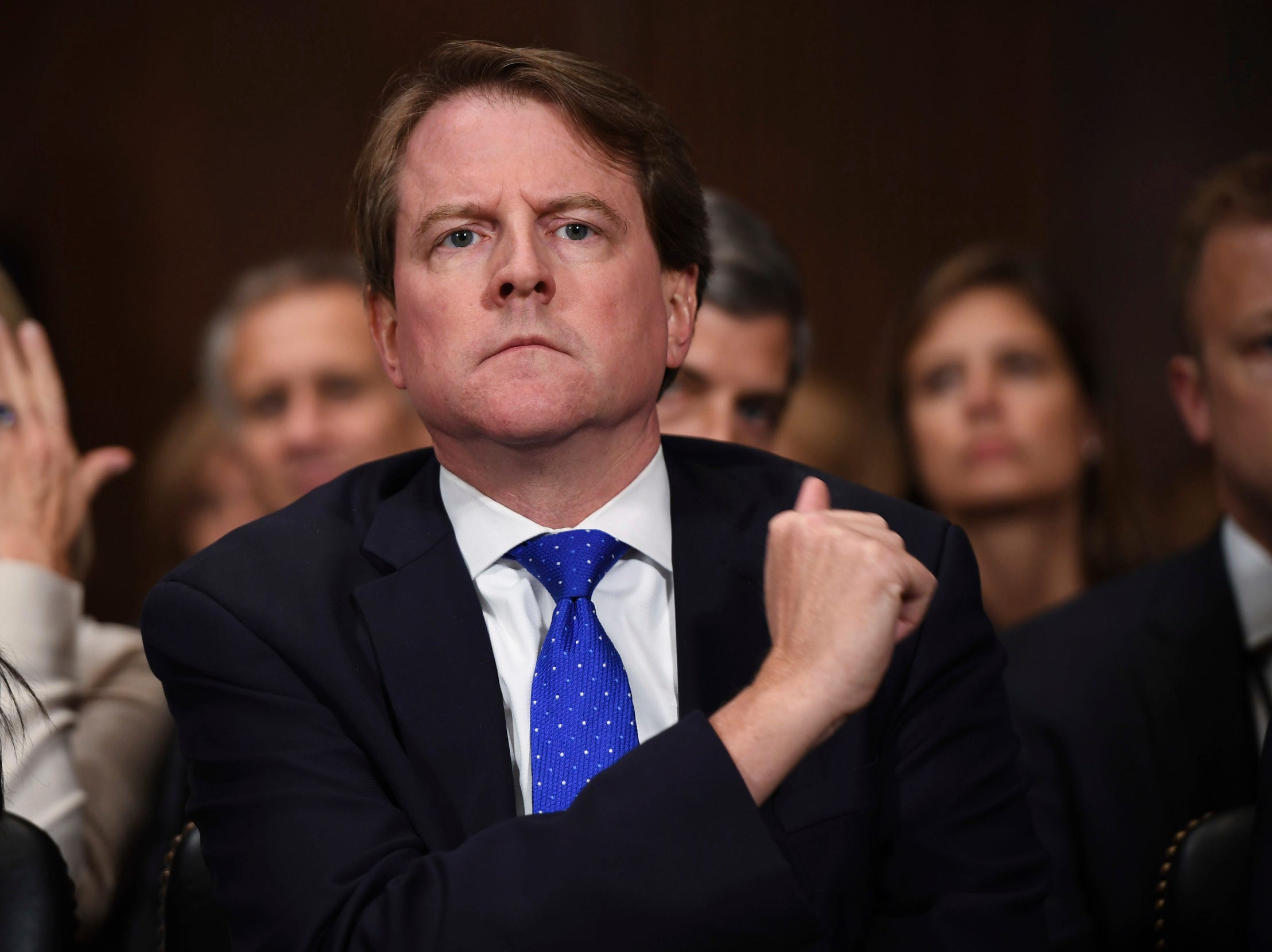 White House counsel Don McGahn listens as Supreme court nominee Brett Kavanaugh testifies before the Senate Judiciary Committee, Thursday.