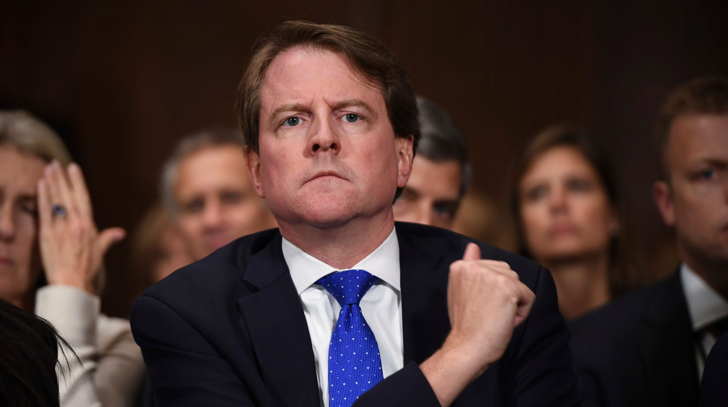 White House counsel Don McGahn listens as Supreme court nominee Brett Kavanaugh testifies before the Senate Judiciary Committee, Thursday.