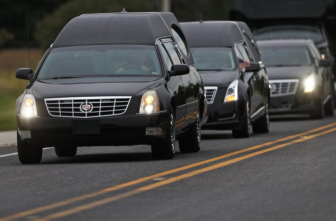 Two hearses are seen a procession of vehicles leaving Trader's Point Christian Church in Whitestown, Thursday, Sept. 27, 2018, after the celebration of life for Harrison and Shelby Hunn.  The Zionsville teens were killed in an apparent double murder-suicide Sept. 21, 2018.