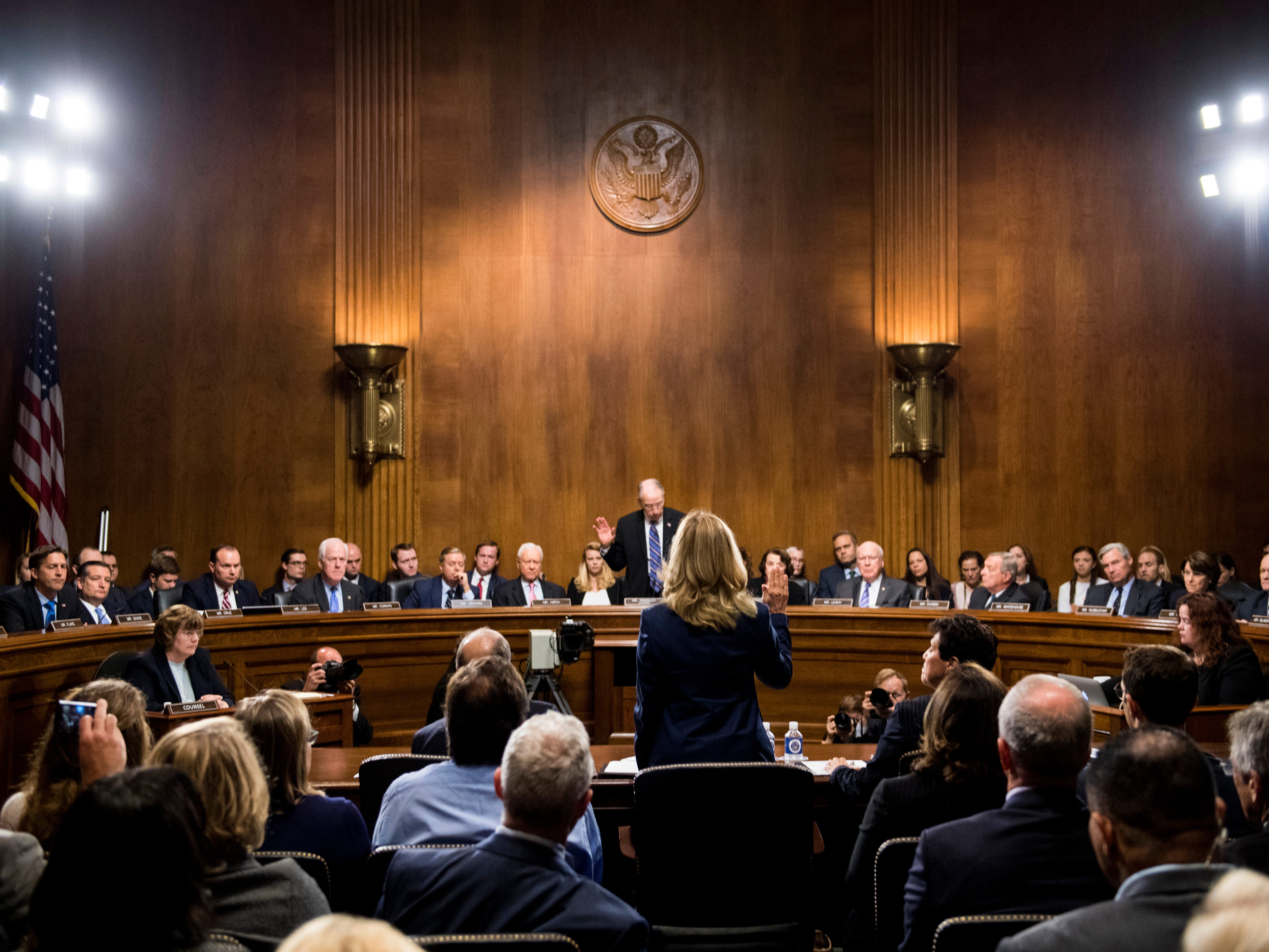 Christine Blasey Ford is sworn in by Senate Judiciary Committee chairman Chuck Grassley, R-Iowa, to testify before the Senate Judiciary Committee on Capitol Hill in Washington, Thursday, Sept. 27, 2018.  (Tom Williams/Pool Photo via AP) ORG XMIT: DCJE425