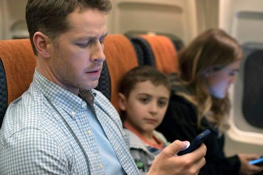 "Ben (far left, Josh Dallas), Cal (Jack Messina) and Michaela (Melissa Roxburgh) on the flight that changes their lives on ""Manifest."""