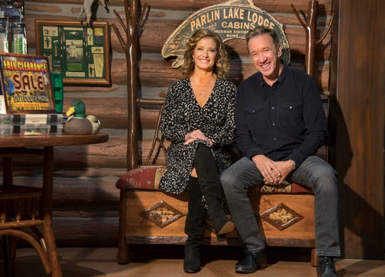 'Last Man Standing' stars Nancy Travis, left, and Tim Allen enjoy a moment on the Outdoor Man store set on a recent taping day of the Fox sitcom.