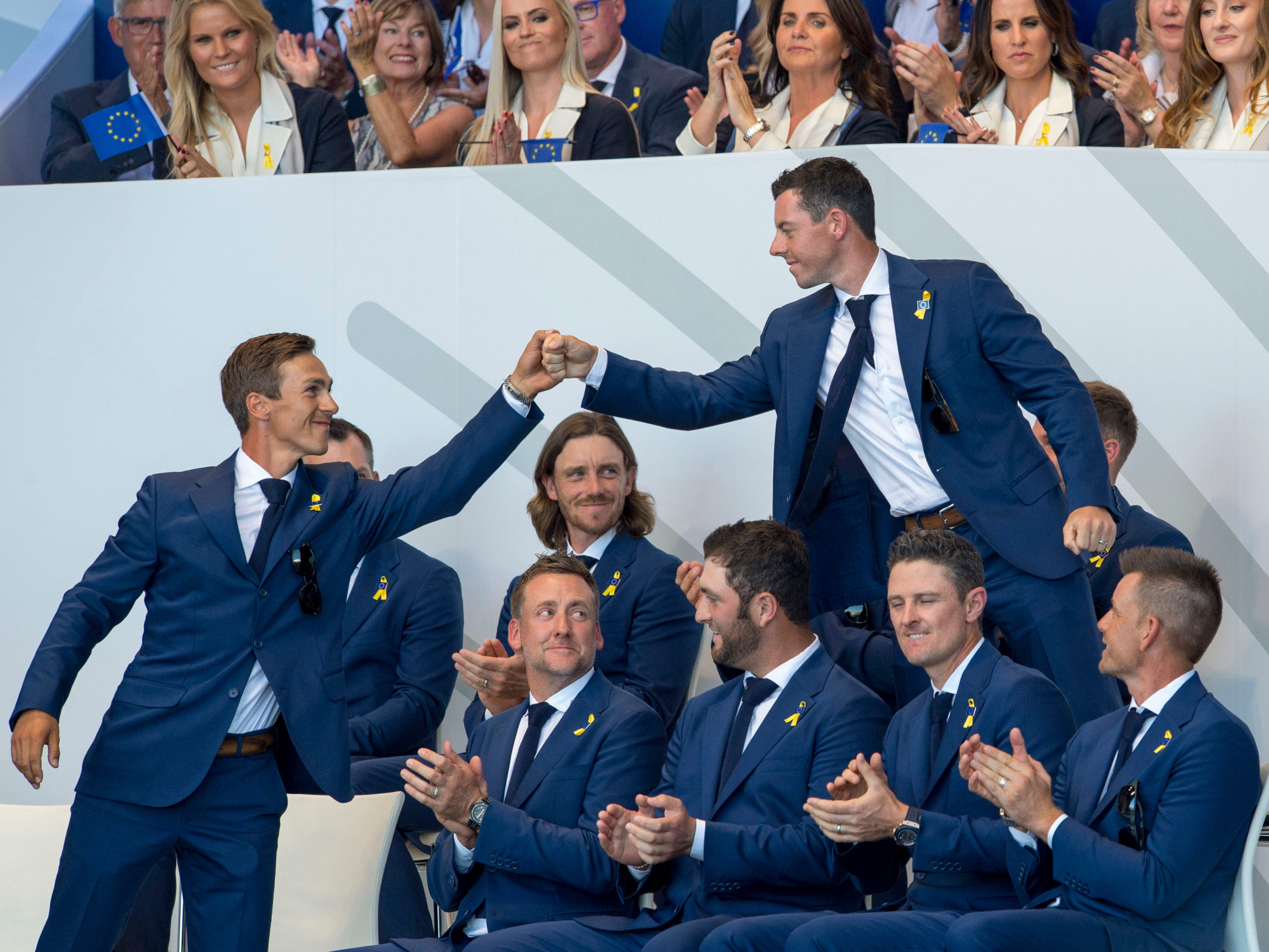 European team members Thorbjorn Olesen and Rory McIlroy fist bump after being announced to play together in the morning fourballs Ryder Cup Opening Ceremony.