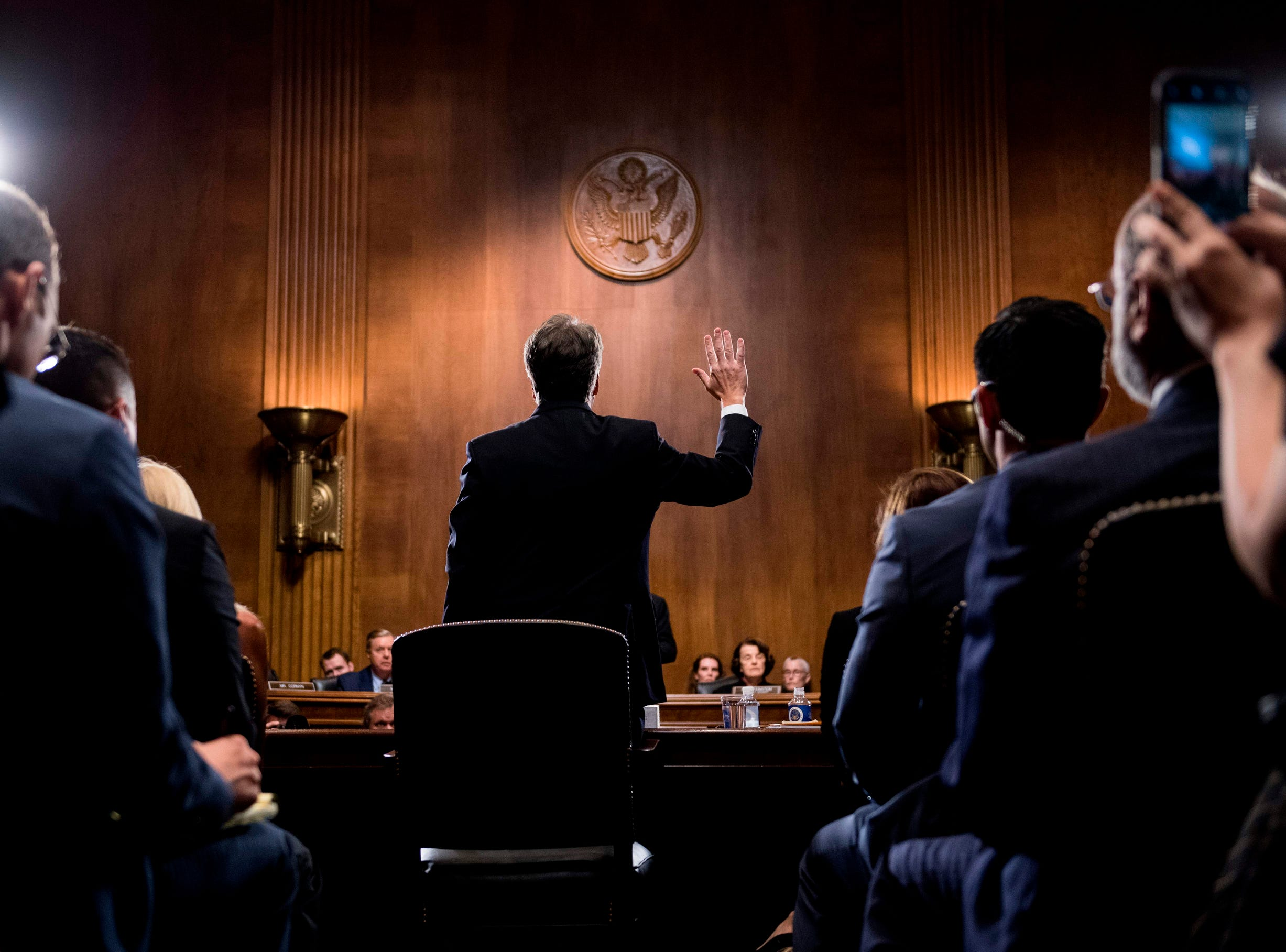 """US Supreme Court nominee Judge Brett Kavanaugh is sworn in before testifying at the Senate Judiciary Committee hearing.  University professor Christine Blasey Ford, 51, told a tense Senate Judiciary Committee hearing that could make or break Kavanaugh's nomination she was """"100 percent"""" certain he was the assailant and it was """"absolutely not"""" a case of mistaken identify."""