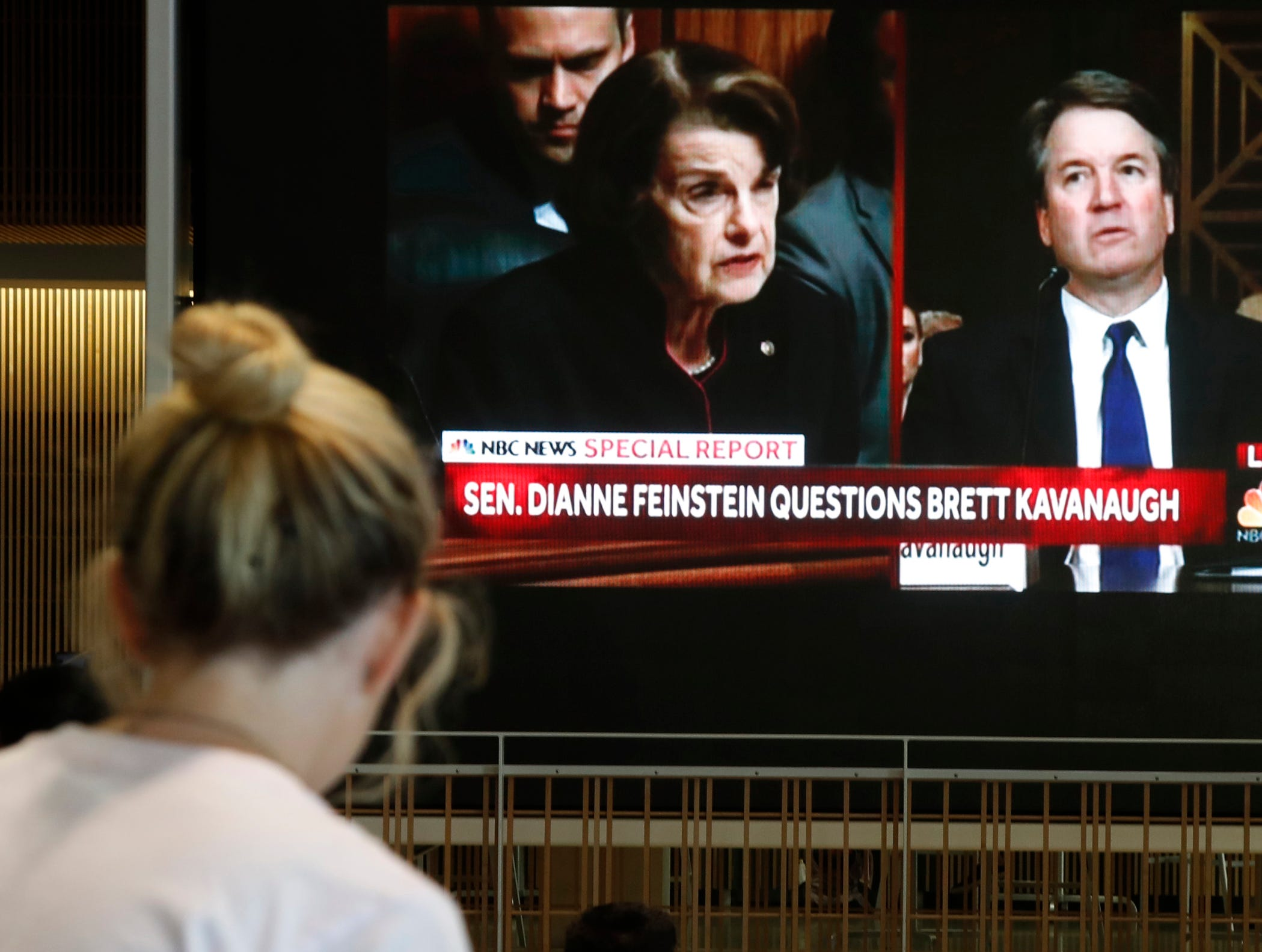 A student watches as Brett Kavanaugh is questioned by US Senator Dianne Feinstein at the Senate Judiciary Committee hearing on the nomination of Brett Kavanaugh to be an associate justice of the Supreme Court.