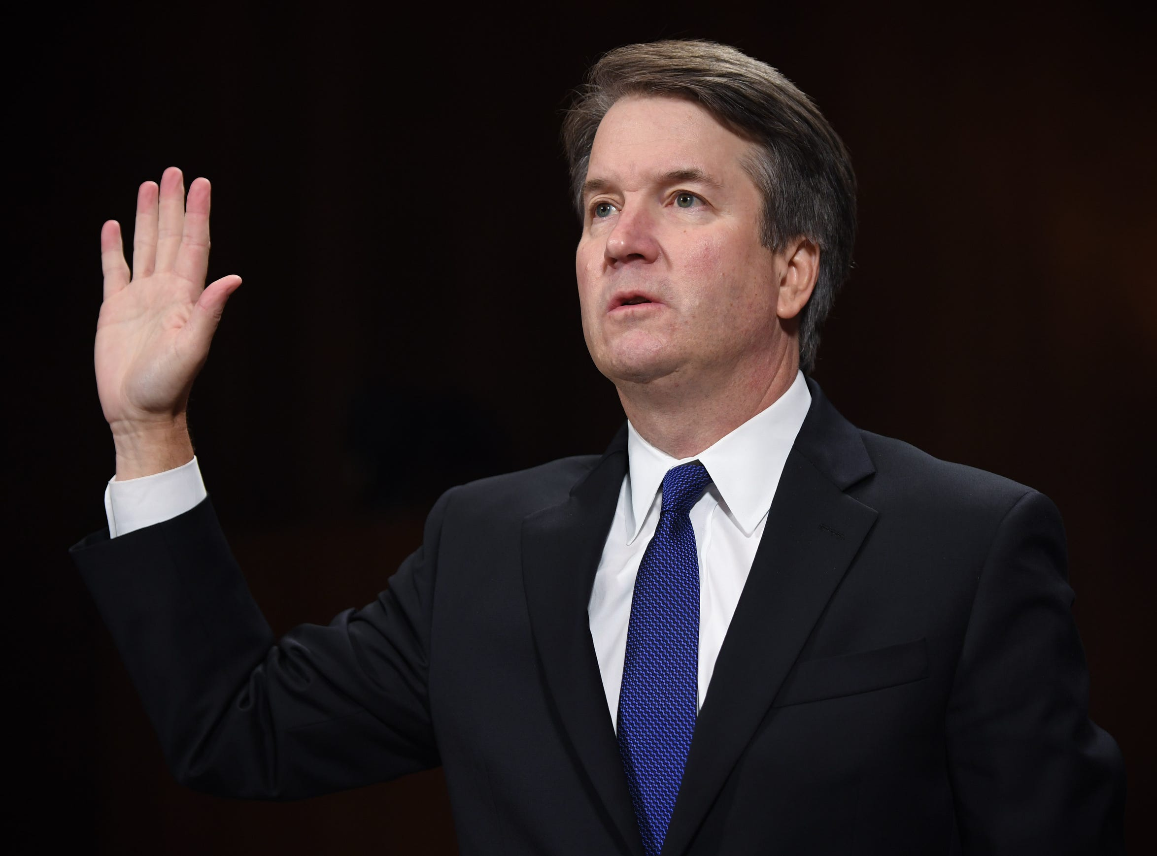 Supreme Court nominee Judge Brett Kavanaugh is sworn in to testify before the US Senate Judiciary Committee on Capitol Hill in Washington, DC, Sept. 27, 2018.
