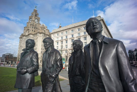 The new statues of Paul McCartney, George Harrison,  Ringo Starr and John Lennon of the Beatles at the Liverpool Waterfront on Feb. 11, 2016 in Liverpool, England.