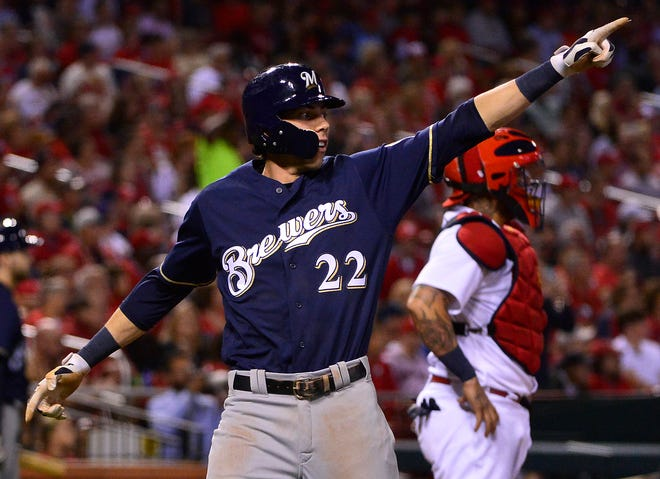 Christian Yelich celebrates after scoring on a single by Travis Shaw.