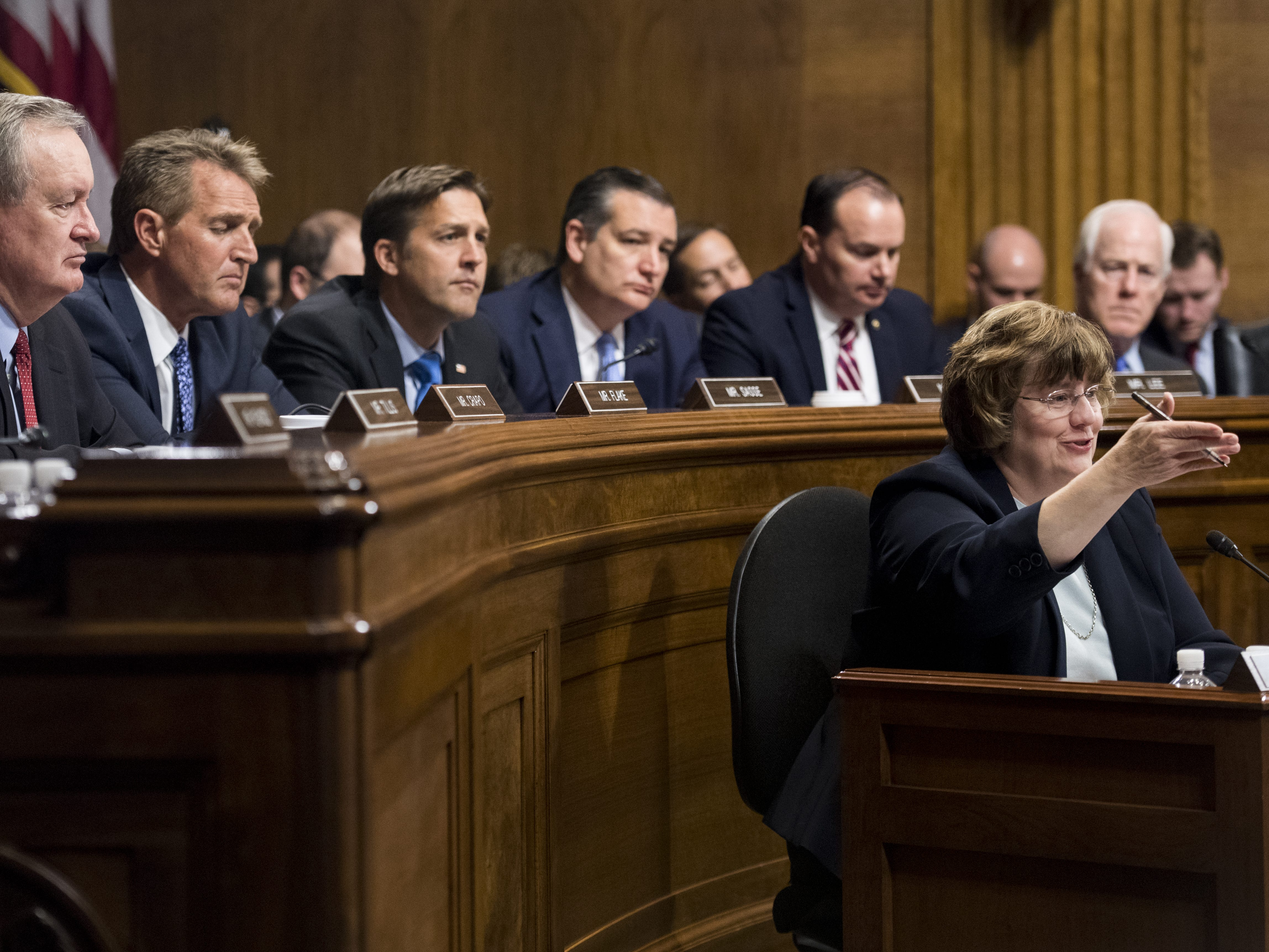 WASHINGTON, DC - SEPTEMBER 27: Rachel Mitchell, counsel for Senate Judiciary Committee Republicans, questions Dr. Christine Blasey Ford as Senators, from left, Ben Sasse, R-Neb., Ted Cruz, R-Texas, Mike Lee, R-Utah.,  and John Cornyn, R-Texas, listen during the Senate Judiciary Committee hearing on Capitol Hill September 27, 2018 in Washington, DC. A professor at Palo Alto University and a research psychologist at the Stanford University School of Medicine, Ford has accused Supreme Court nominee Judge Brett Kavanaugh of sexually assaulting her during a party in 1982 when they were high school students in suburban Maryland. (Photo By Supporters of Supreme Court nominee Brett Kavanaugh gather outside of the Dirksen Senate Office Building-Pool/Getty Images) ORG XMIT: 775234142 ORIG FILE ID: 1041760028