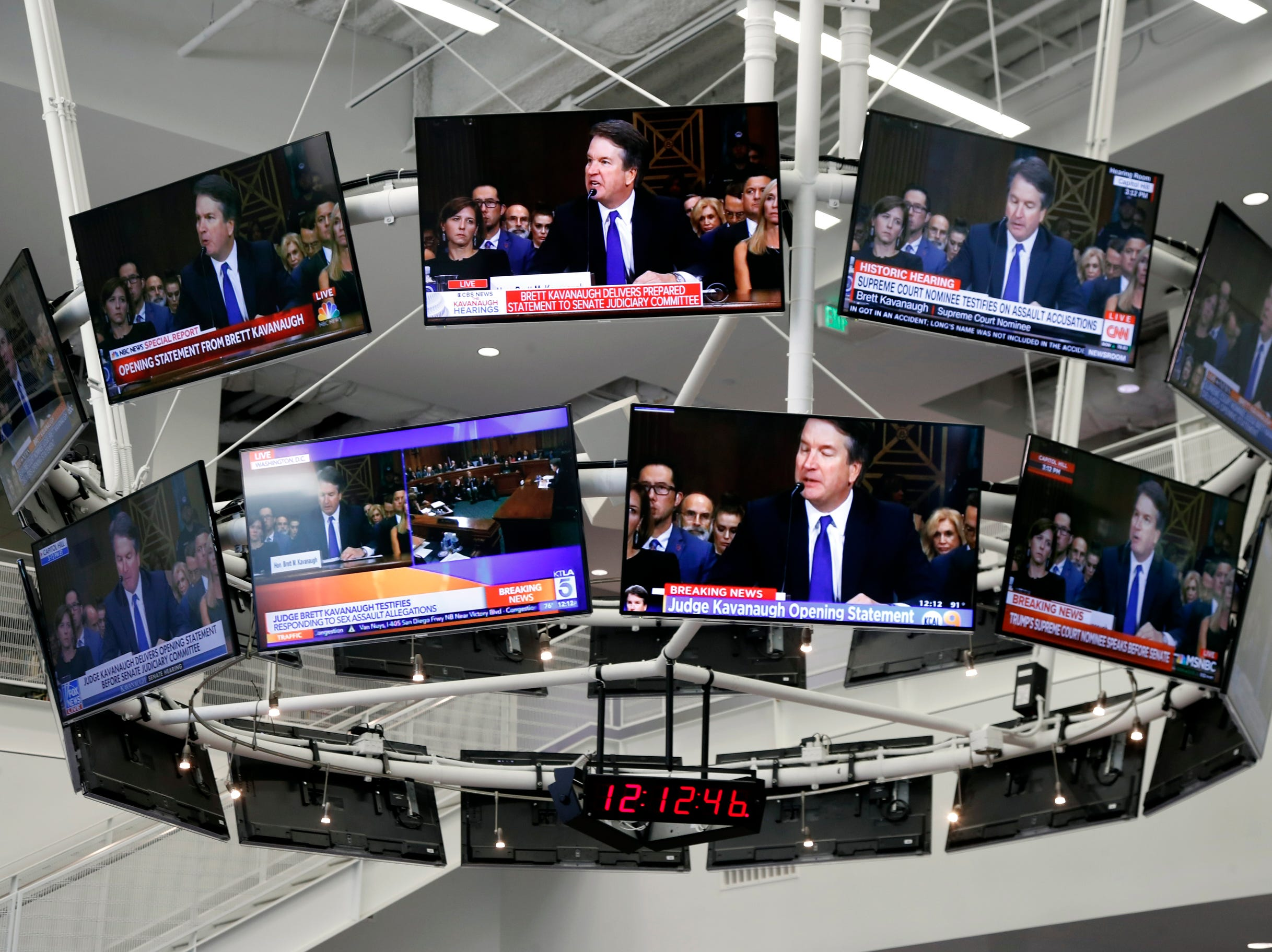 A bank of televisions show Brett Kavanaugh testifying at the Senate Judiciary Committee hearing on the nomination of Brett Kavanaugh to be an associate justice of the Supreme Court of the United States, at a the USC Annenberg School for Communication and Journalism.