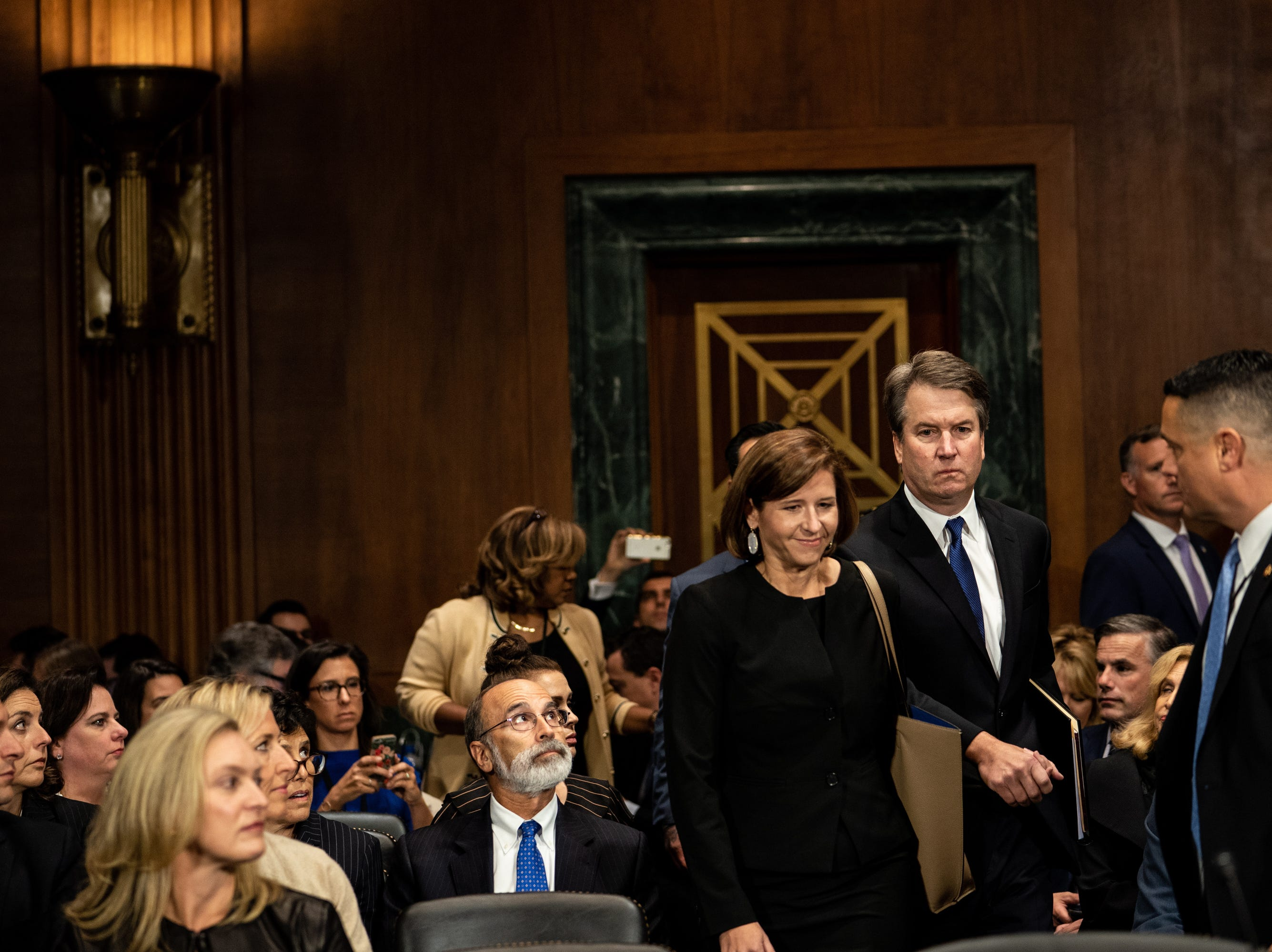 Supreme Court nominee Judge Brett Kavanaugh (C-R) with his wife Ashley (C-L) attend the Senate Judiciary Committee hearing on his nomination to be an associate justice of the Supreme Court of the United States. Trump's nominee to be a US Supreme Court associate justice Brett Kavanaugh is in a tumultuous confirmation process as multiple women have accused Kavanaugh of sexual misconduct.