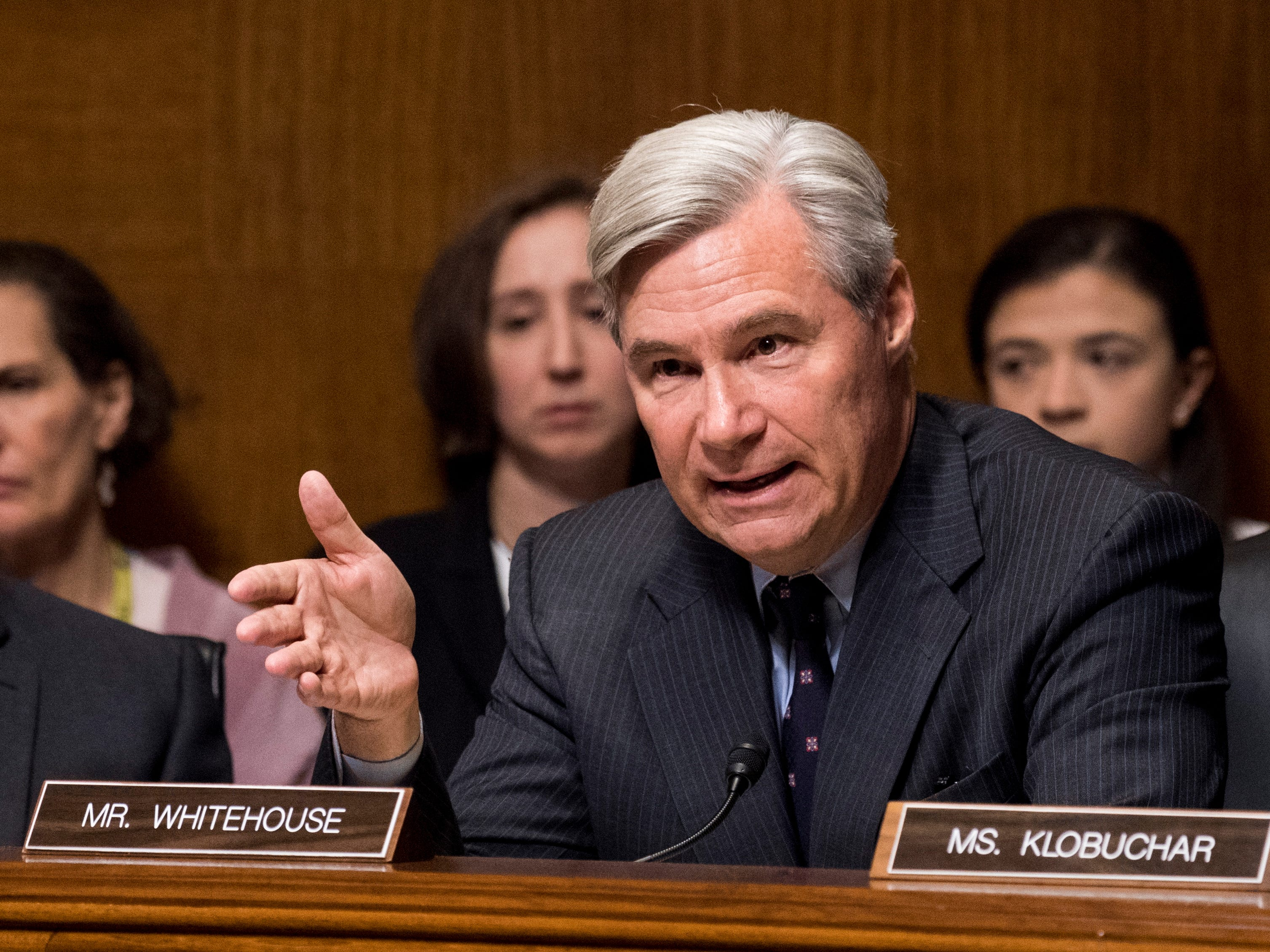 epa07051719 Senator Sheldon Whitehouse (C), D-R.I., questions Christine Blasey Ford (unseen) as Senator Richard Durbin (L), D-Ill., and Senator Amy Klobuchar (R), D-Minn., listen during the Senate Judiciary Committee hearing on the nomination of Brett Kavanaugh to be an associate justice of the Supreme Court of the United States, on Capitol Hill in Washington, DC, USA, 27 September 2018. US President Donald J. Trump's nominee to be a US Supreme Court associate justice Brett Kavanaugh is in a tumultuous confirmation process as multiple women have accused Kavanaugh of sexual misconduct.  EPA-EFE/TOM WILLIAMS / POOL