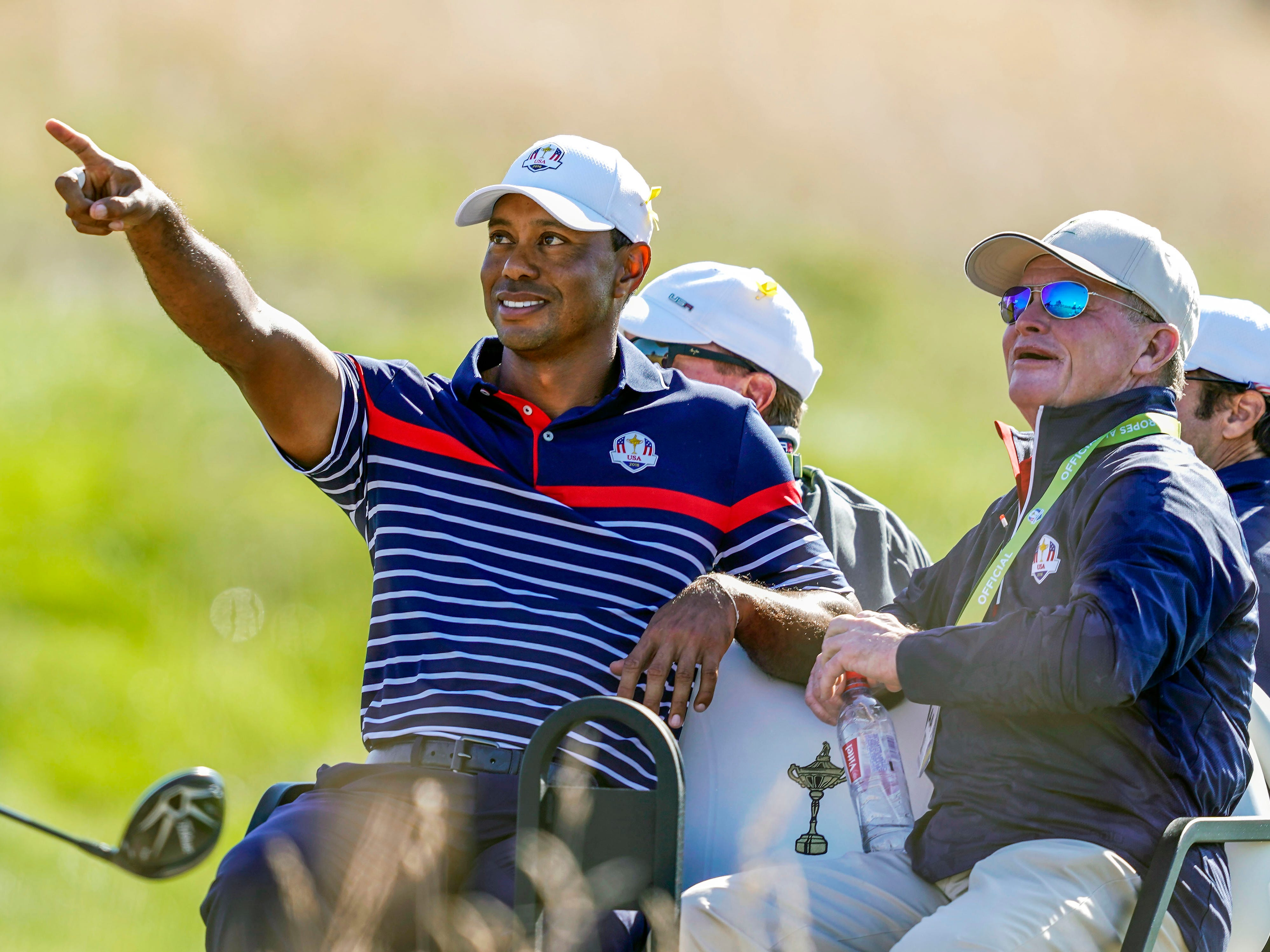 Tiger Woods points out aircraft flying overhead to Tom Kite during a Ryder Cup practice round.