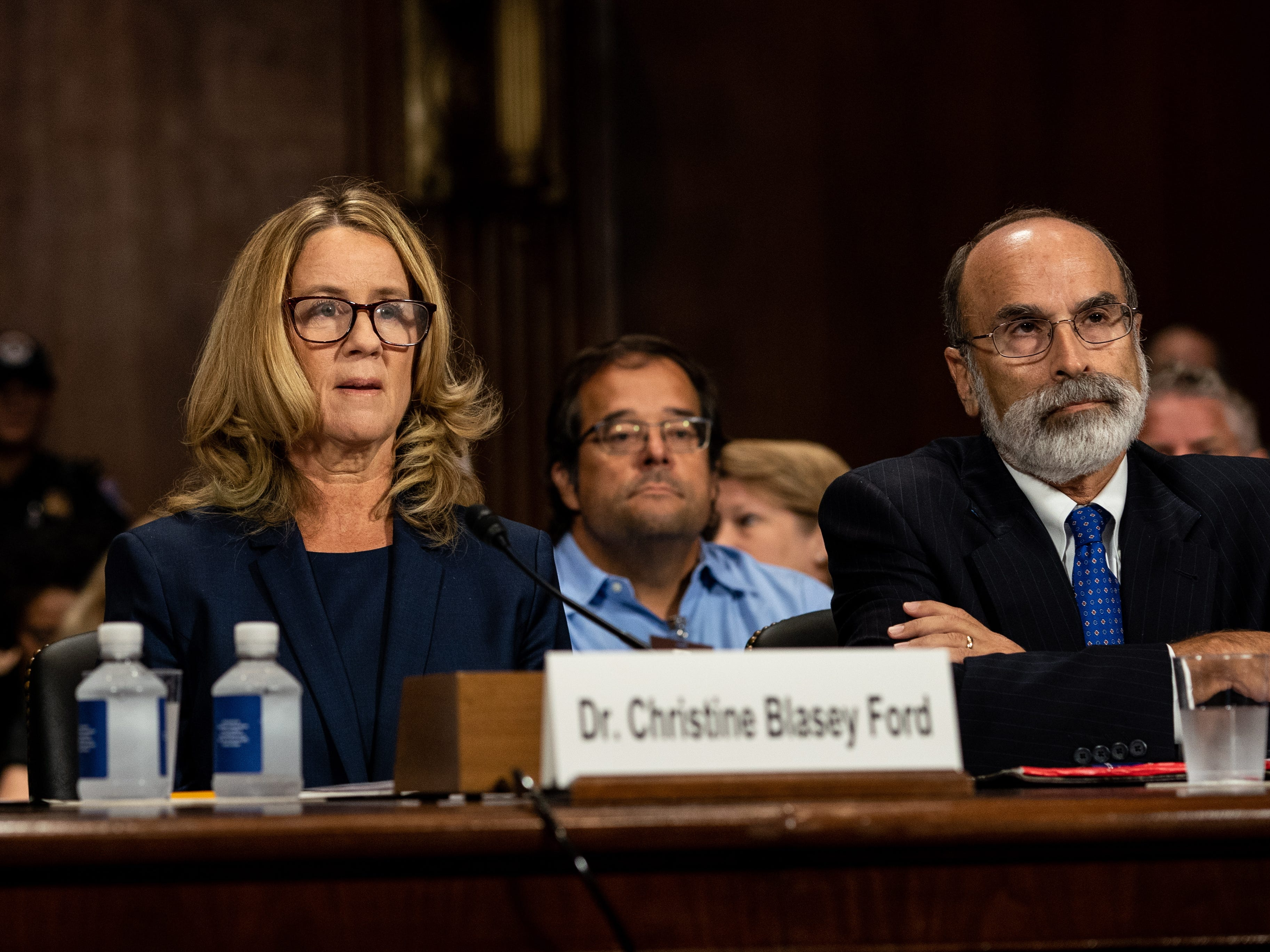 epa07051151 Dr. Christine Blasey Ford (C) with her lawyers Debra S. Katz (L) and Michael R. Bromwich (R) speaks  before the Senate Judiciary Committee hearing on the nomination of Brett Kavanaugh to be an associate justice of the Supreme Court of the United States, on Capitol Hill in Washington, DC, USA, 27 September 2018. US President Donald J. Trump's nominee to be a US Supreme Court associate justice Brett Kavanaugh is in a tumultuous confirmation process as multiple women have accused Kavanaugh of sexual misconduct.  EPA-EFE/ERIN SCHAFF / POOL ORG XMIT: NYT100