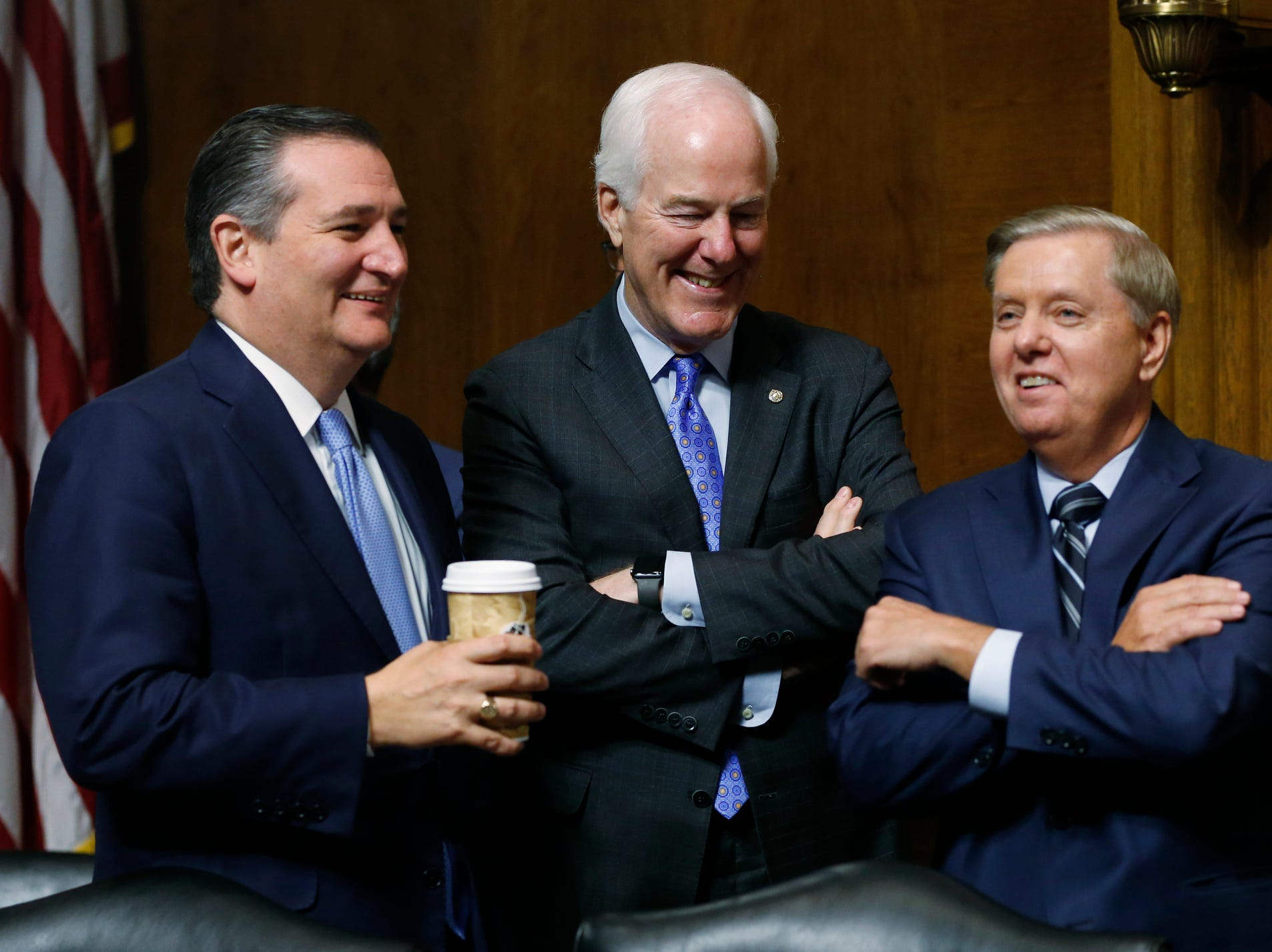 Republican Senators from left, Sen. Ted Cruz, R-Texas, Sen. John Cornyn, R-Texas and Sen. Lindsey Graham, R-S.C., talk during a break in the hearing with Supreme Court nominee Brett Kavanaugh.