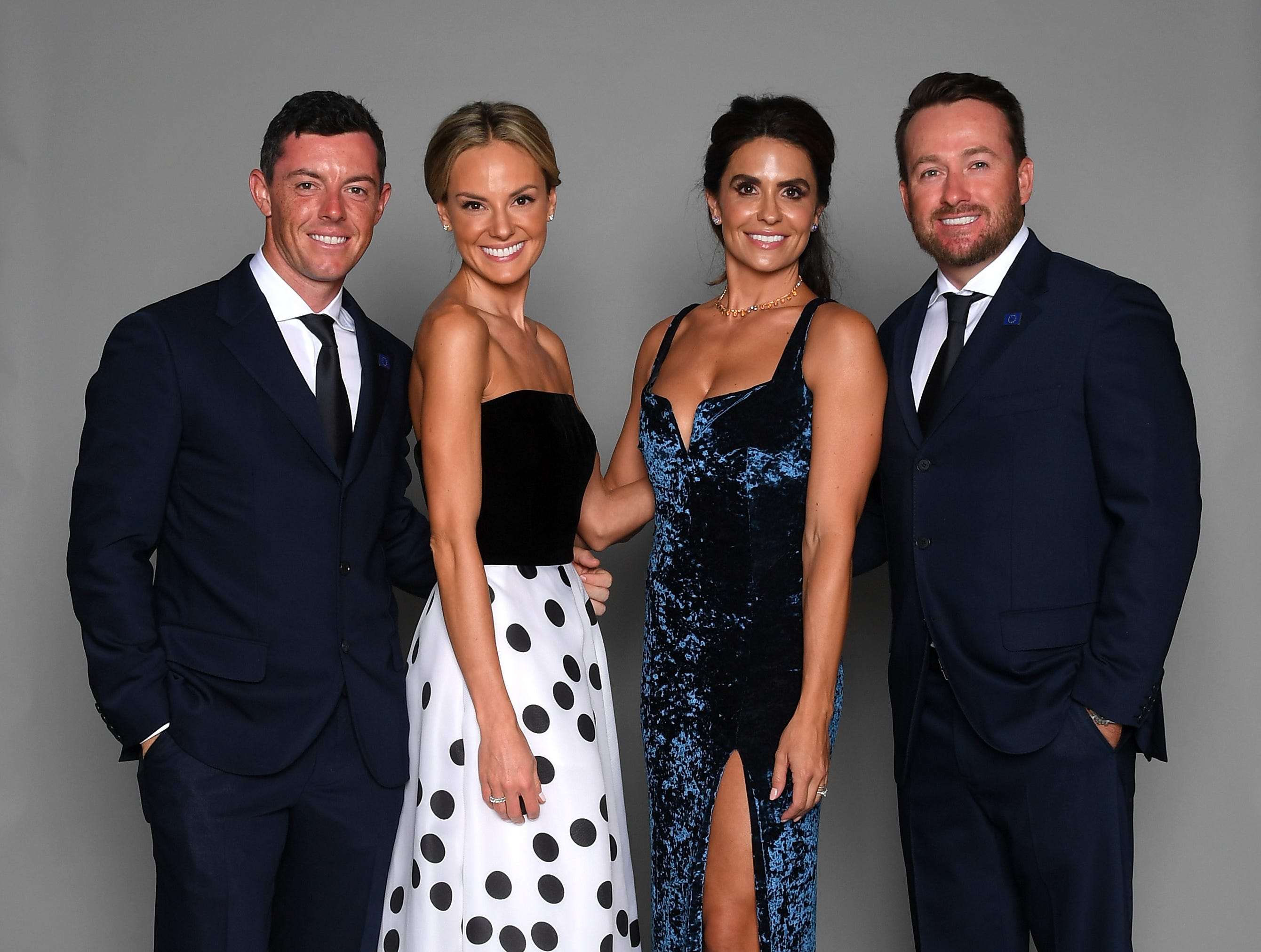Rory McIlroy of Europe, wife Erica McIlroy, Kristin McDowell and Graeme McDowell of Europe pose for a portrait before the gala.