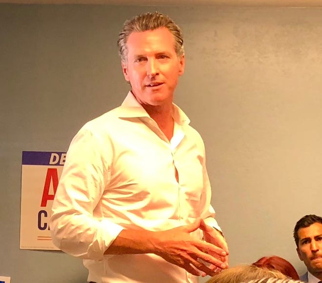 Gavin Newsom, California's Democratic candidate for governor, speaks with supporters inside a small campaign headquarters for state political leaders in Salinas, a few hours south of San Francisco.
