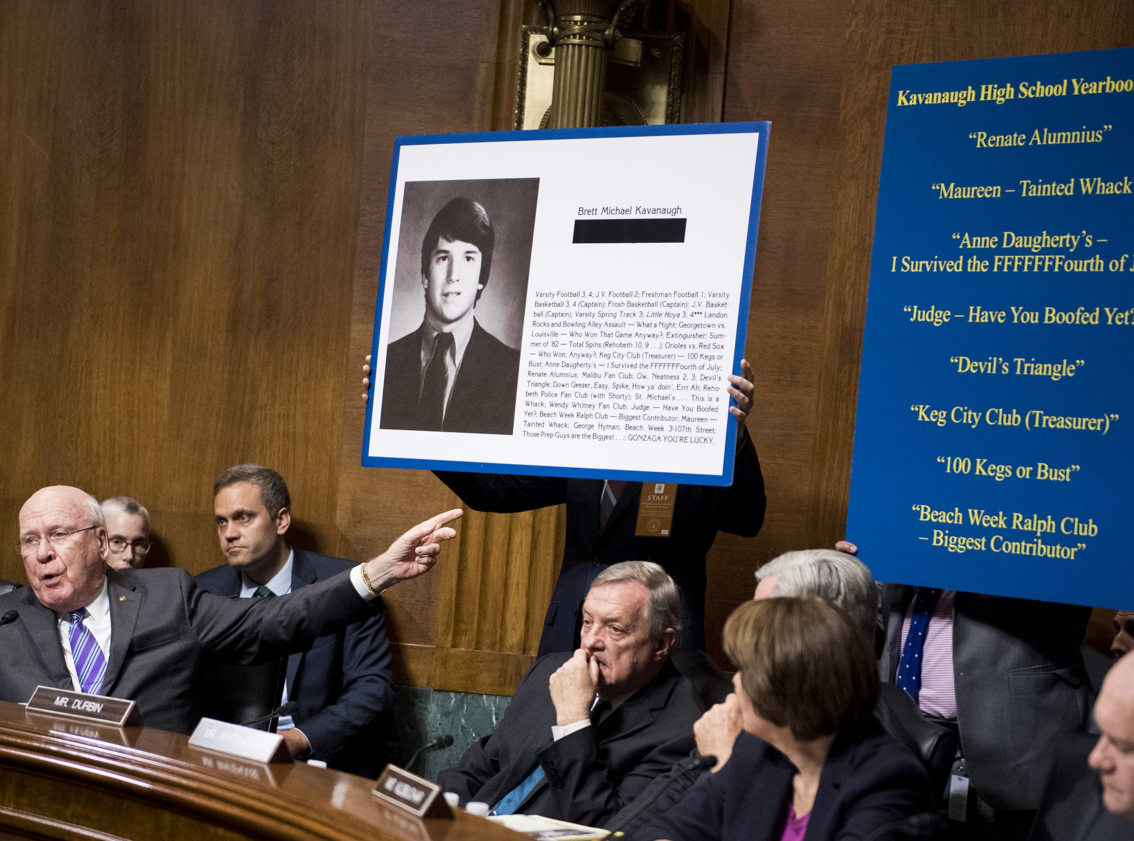Sen. Patrick Leahy, D-Vt., points to posters as he questions Judge Brett Kavanaugh during the Senate Judiciary Committee hearing on his nomination be an associate justice of the Supreme Court.