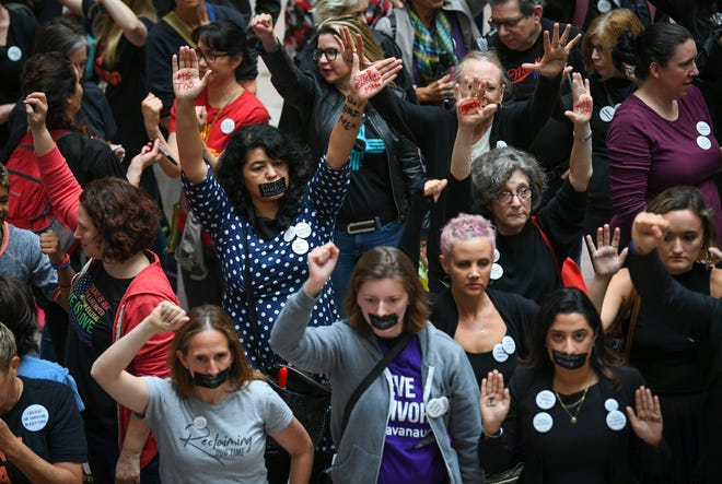 Protesters gather as Christine Blasey Ford testifies on Capitol Hill on Sept. 27, 2018.