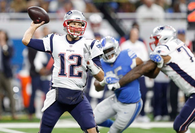 New England Patriots quarterback Tom Brady (12) passes the ball during the second quarter against the Detroit Lions at Ford Field.