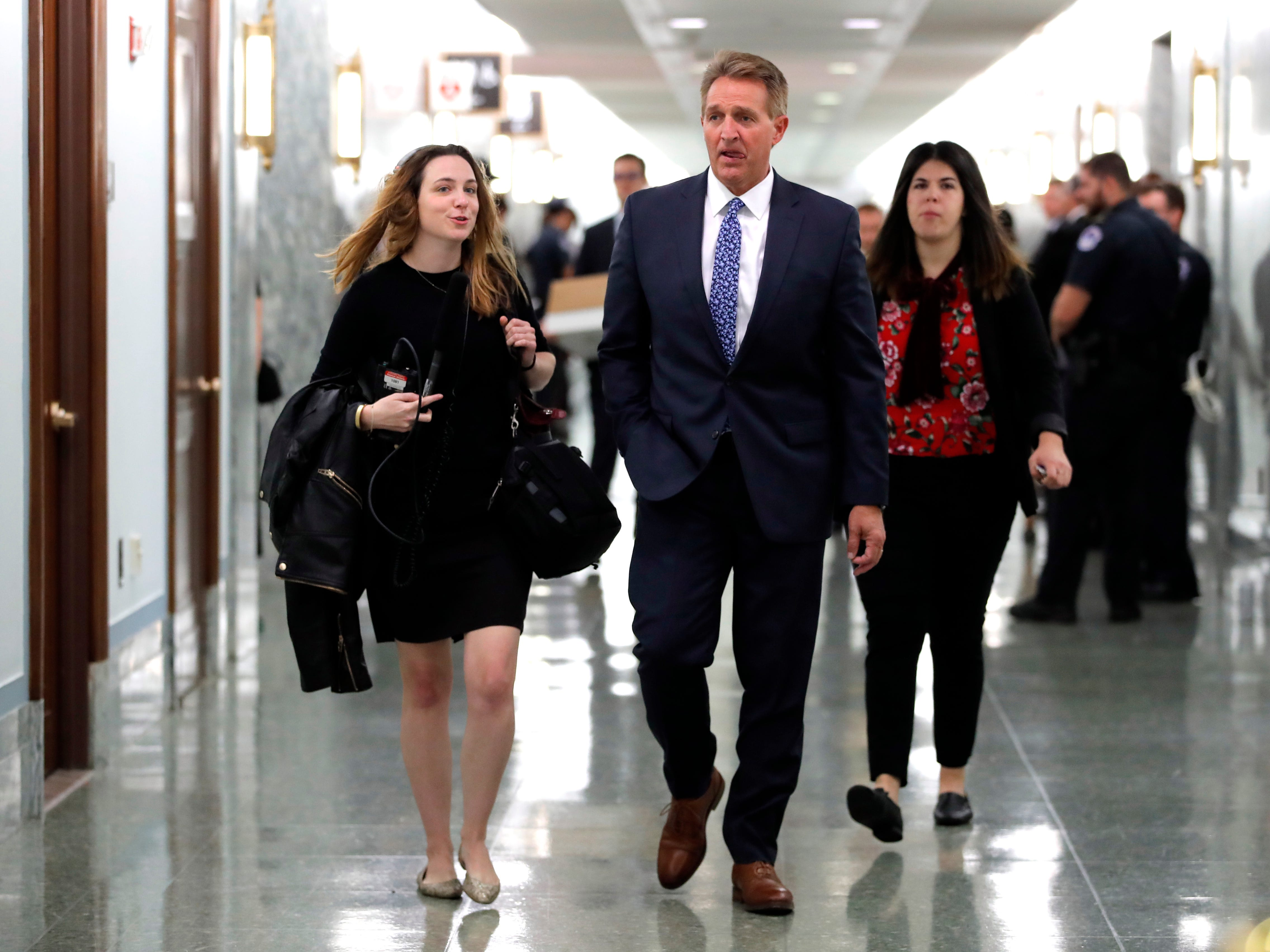 Sen. Jeff Flake, R-Ariz., arrives for the Senate Judiciary hearing on Capitol Hill in Washington, Thursday, Sept. 27, 2018 with Christine Blasey Ford and Supreme Court nominee Brett Kavanaugh.(AP Photo/Carolyn Kaster) ORG XMIT: DCCK403