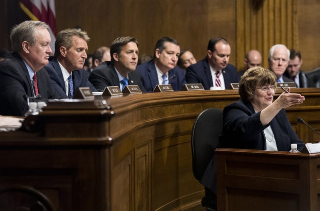 Rachel Mitchell, counsel for Senate Judiciary Committee Republicans, questions Christine Blasey Ford as senators, from left, Ben Sasse, R-Neb., Ted Cruz, R-Texas, Mike Lee, R-Utah.,  and John Cornyn, R-Texas, listen during the Senate Judiciary Committee hearing on Capitol Hill Sept. 27, 2018, in Washington, D.C.