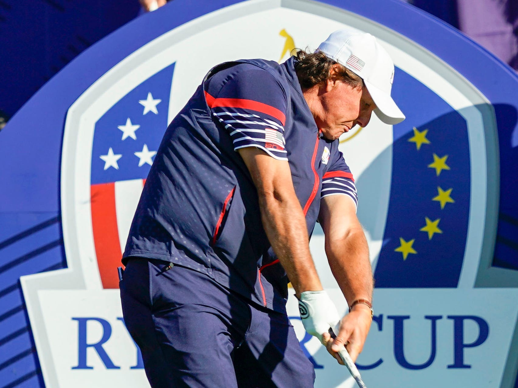 Phil Mickelson tees off at the hole during a Ryder Cup practice round.