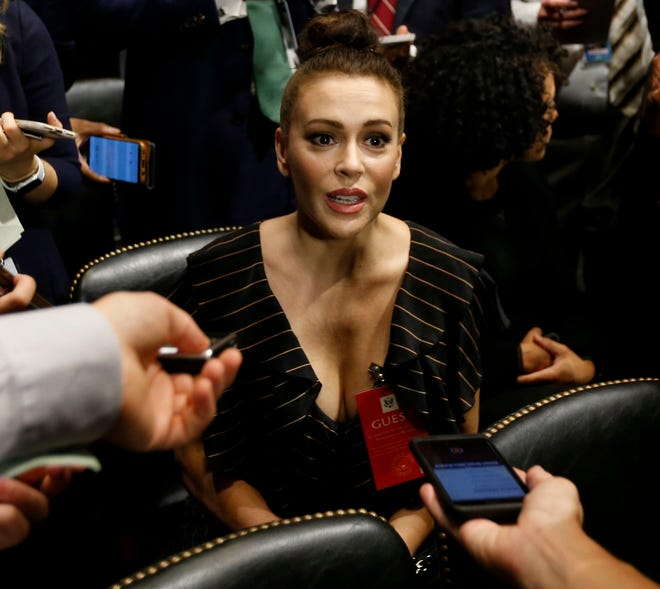 Actress Alyssa Milano talks to media before the Senate Judiciary Committee hearing on the nomination of Brett Kavanaugh to be an associate justice of the Supreme Court of the US on Sept. 27, 2018.